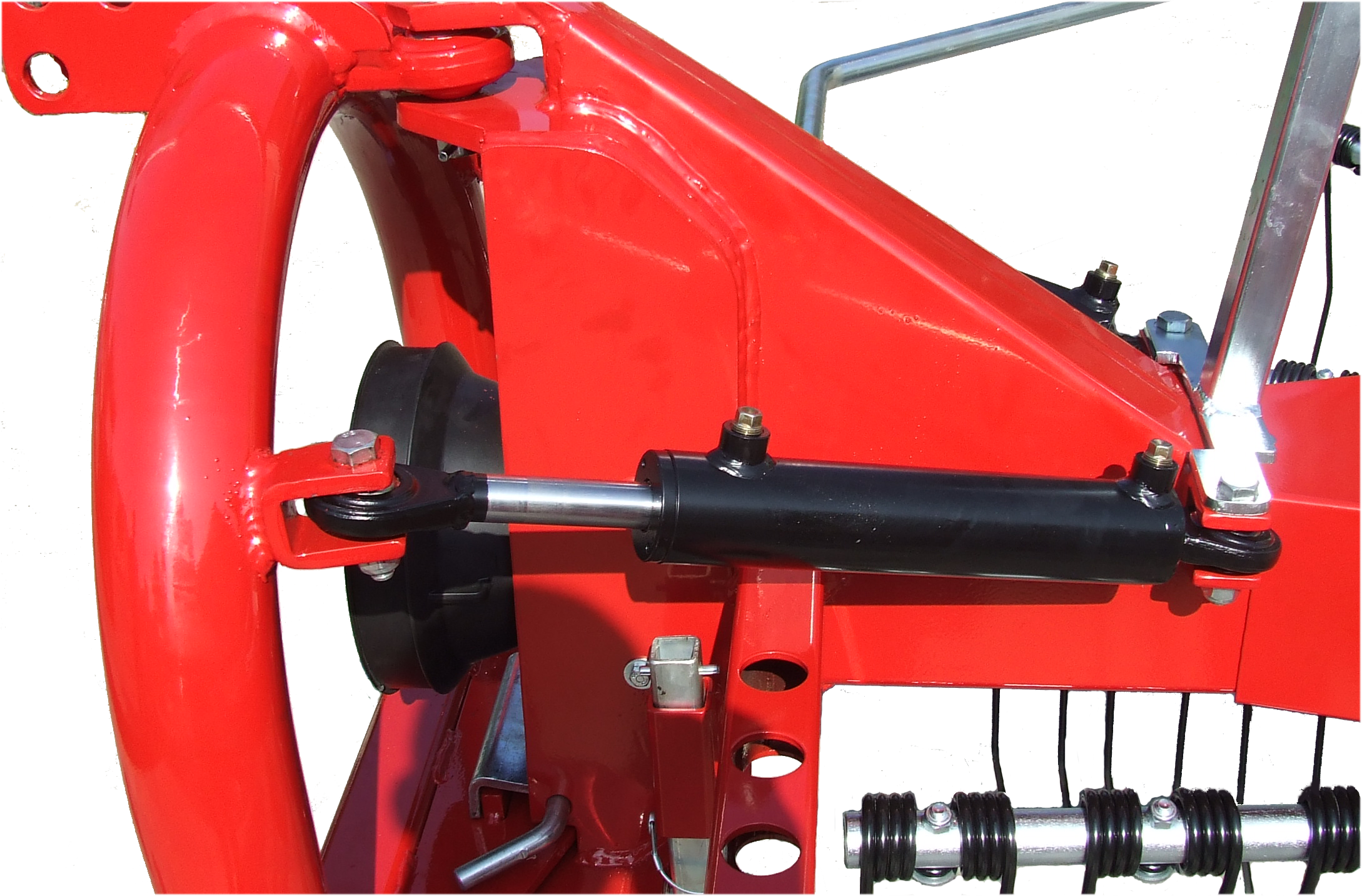 shock absorber cylinder for articulated rotary rake
